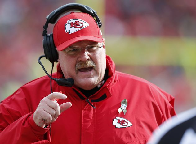 Kansas City Chiefs head coach Andy Reid talks with a game official during the first half of an NFL football game against the San Diego Chargers in Kansas City, Mo., Sunday, Nov. 24, 2013. (AP Photo/Ed Zurga)