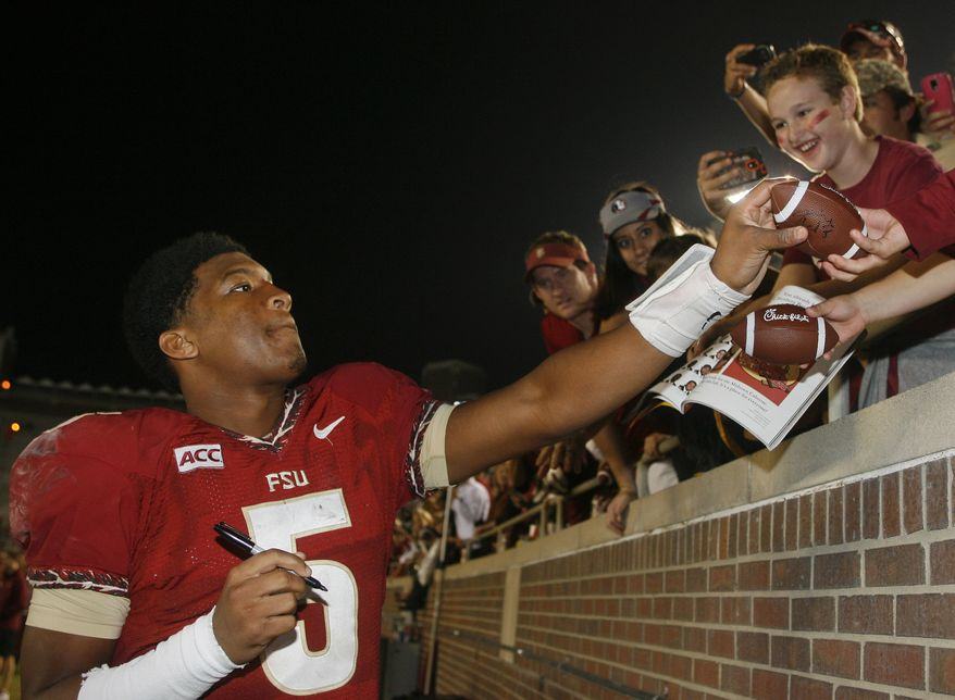 FILE - In a Saturday, Nov. 23, 2013 file photo, Florida State quarterback Jameis Winston (5) signs autographs after an NCAA college football game against Idaho, in Tallahassee, Fla. Its handling of sexual assault allegations against Florida State quarterback Winston is just the latest controversy to hit the Tallahassee Police Department. A handful of grand juries recently have issued scathing reports about how some officers have conducted themselves in the line of duty.(AP Photo/Phil Sears, File)