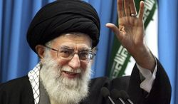 In this Feb. 3, 2012, file photo, released by an official website of the Iranian supreme leader's office, Iranian supreme leader Ayatollah Ali Khamenei waves to the worshippers before he delivers his Friday prayers sermon, at the Tehran University campus, Iran. (AP Photo/Office of the Supreme Leader, File)