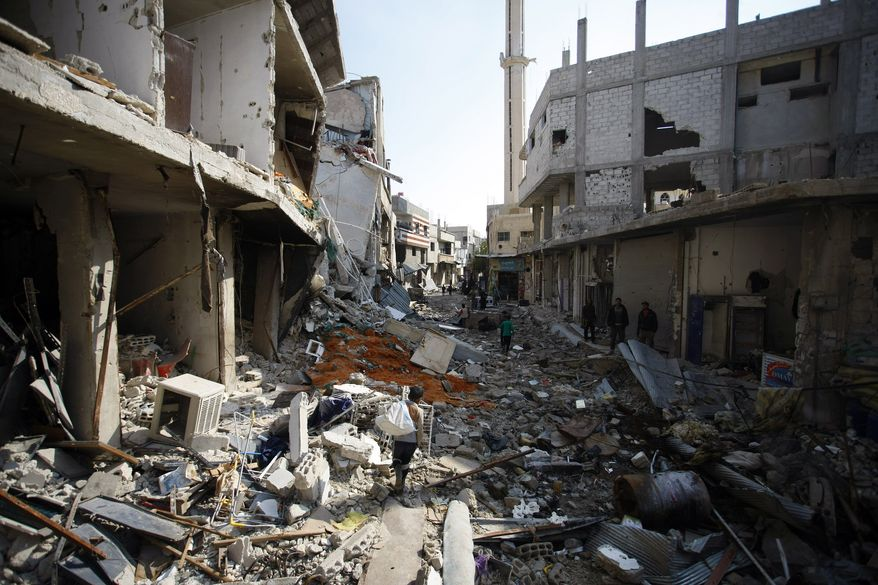 On Wednesday, Nov. 20, 2013, Syrian civilians look for undamaged furniture, clothes and food in their homes, which were destroyed during clashes between the Sunni-dominated Free Syrian Army and Syrian soldiers loyal to Syrian President Bashar Assad, supported by Iraqi and Lebanese Shiite fighters, in the town of Hejeira, which Syrian troops captured, in the countryside near Damascus, Syria. (AP Photo/Jaber al-Helo)