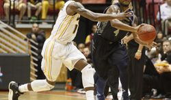 VCU guard Rob Brandenberg, left, pressures Georgetown guard D'Vauntes Smith-Rivera during an NCAA college basketball game in San Juan, Puerto Rico, Sunday, Nov. 24, 2013. (AP Photo/Ricardo Arduengo)