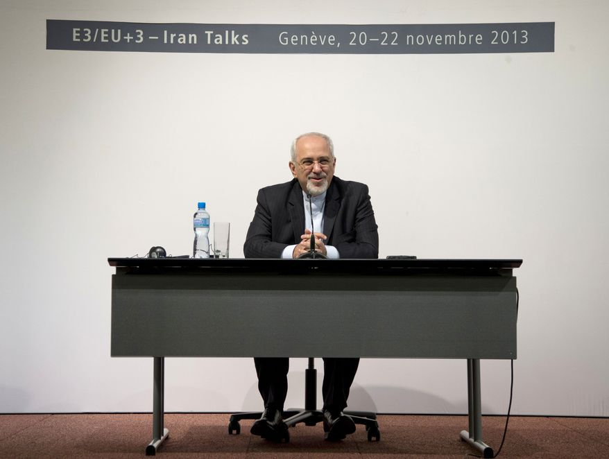 Iranian Foreign Minister Mohammad Javad Zarif speaks to the media at the International Conference Centre of Geneva, Sunday, Nov. 24, 2013, in Geneva, Switzerland. Iran struck a historic nuclear deal Sunday with the United States and five other world powers, in the most significant development between Washington and Tehran in more than three decades of estrangement between the two nations.  The agreement commits Iran to curb its nuclear activities in exchange for limited and gradual sanctions relief.(AP Photo/Carolyn Kaster, Pool)