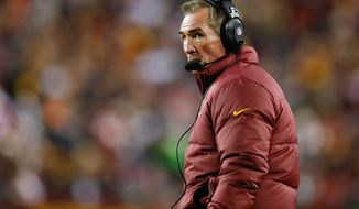 Washington Redskins head coach Mike Shanahan watches the action from the sidelines during the first half of an NFL football game against the San Francisco 49ers in Landover, Md., Monday, Nov. 25, 2013. (AP Photo/Evan Vucci)