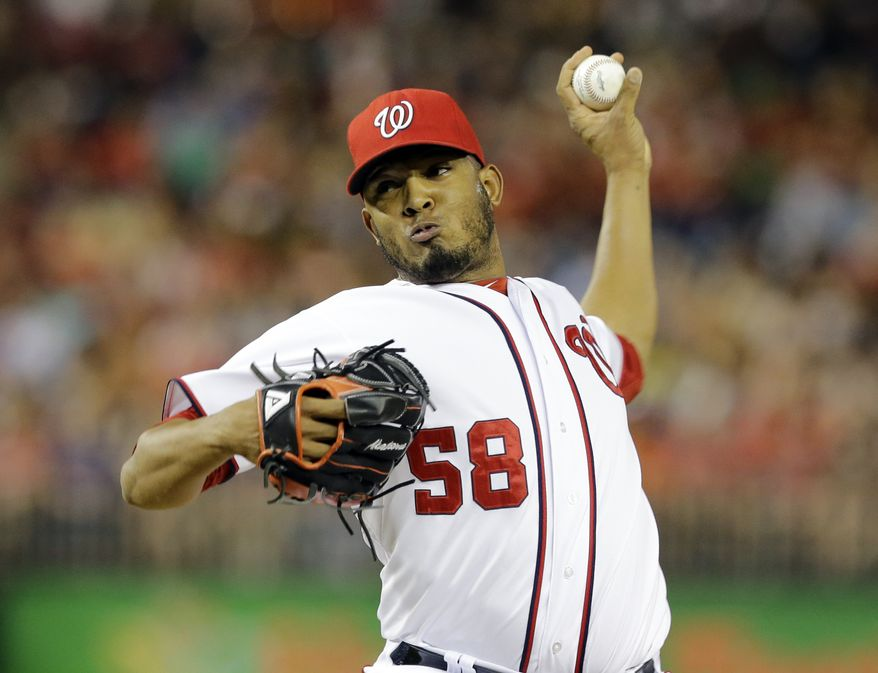 Washington Nationals relief pitcher Fernando Abad (58) throws during a baseball game against the New York Mets at Nationals Park Friday, Aug. 30, 2013, in Washington. The Mets won 3-2. (AP Photo/Alex Brandon)