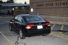 "This image contained in the ""Appendix to Report on the Shootings at Sandy Hook Elementary School and 36 Yogananda St., Newtown, Connecticut On December 14, 2012"" and released Monday, Nov. 25, 2013, by the Danbury, Conn., State's Attorney shows a vehicle outside Sandy Hook Elementary School in Newtown, Conn. Adam Lanza opened fire inside the school killing 20 first-graders and six educators before killing himself as police arrived. (AP Photo/Office of the Connecticut State's Attorney Judicial District of Danbury)"