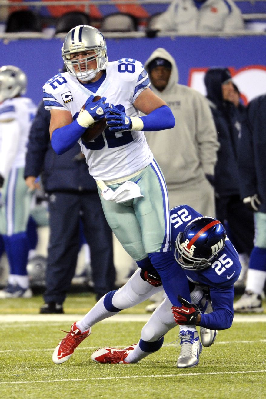 Dallas Cowboys tight end Jason Witten (82) is tackled by New York Giants safety Will Hill during the second half of an NFL football game, Sunday, Nov. 24, 2013, in East Rutherford, N.J. (AP Photo/Bill Kostroun)