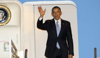 President Obama waves as he arrives at Los Angeles International Airport on Monday, Nov. 25, 2013, in the midst of a multicity political and fundraising swing through the West. (AP Photo/Nick Ut)