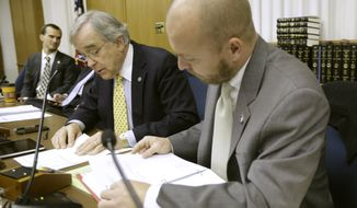 Members of the State Board of Elections, Chairman Charles E. Judd, left, and secretary Don Palmer, right, begin the process to certify the Nov. 5 ballot for the race for Virginia attorney general at the Capitol in Richmond, Va., Monday, Nov. 25, 2013.  Democrat Mark Herring leads Republican Mark Obenshain by 165 votes.   (AP Photo/Steve Helber)