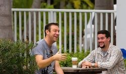 Rep. Trey Radel, Florida Republican (left), sits in a smoking section Tuesday behind the Hazelden addiction treatment facility in Naples, Fla. The freshman congressman is receiving treatment at the facility during a leave of absence after pleading guilty last week to a misdemeanor cocaine possession charge. (associated press)