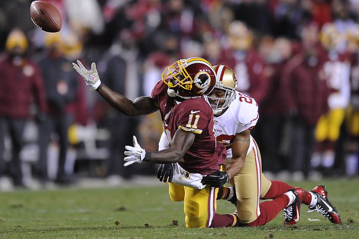 San Francisco 49ers cornerback Carlos Rogers (22) breaks up a deep pass intended for Washington Redskins wide receiver Aldrick Robinson (11) as the Washington Redskins play the San Francisco 49ers at FedExField, Landover, Md., November 25, 2013. (Dan DeCook/Special to The Washington Times)