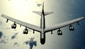 A B-52 bomber flies over the Pacific Ocean. (Image: U.S. Air Force) ** FILE **