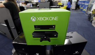 "FILE - In this Friday, Nov. 22, 2013 file photo, The Xbox One is on display at a Best Buy store in Evanston, Ill.  There's a couple of new foes affecting gamers who are proving to be far more destructive than any on-screen villains. With foreboding nicknames like ""the blue light of death"" and ""the disc drive of doom,"" they're the glitches putting a hamper on the next-generation gaming systems Xbox One and PlayStation 4. (AP Photo/Nam Y. Huh, File)"