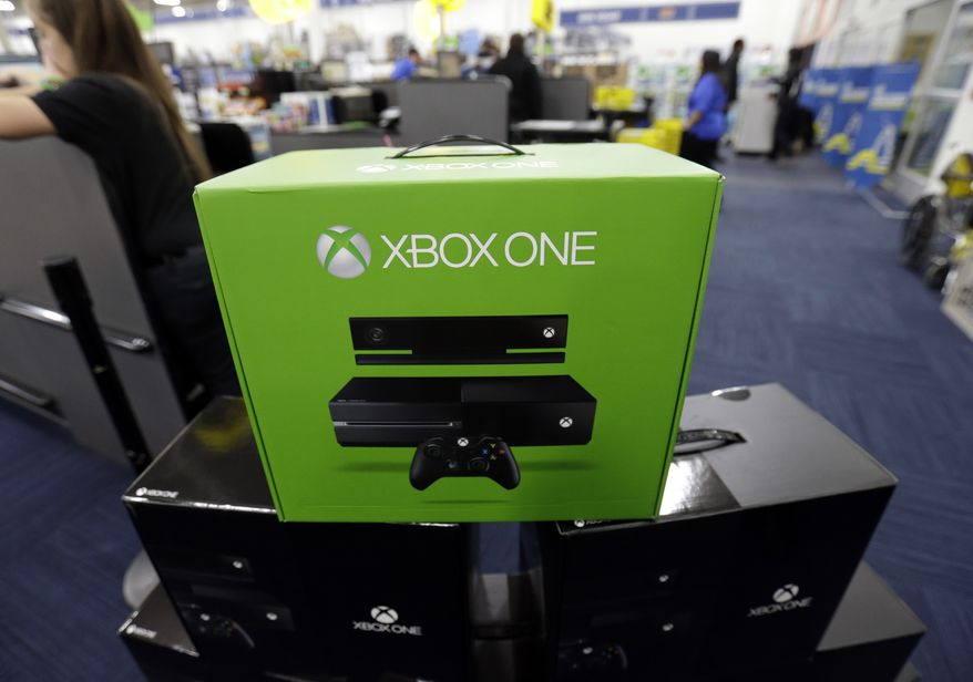 """FILE - In this Friday, Nov. 22, 2013 file photo, The Xbox One is on display at a Best Buy store in Evanston, Ill.  There's a couple of new foes affecting gamers who are proving to be far more destructive than any on-screen villains. With foreboding nicknames like """"the blue light of death"""" and """"the disc drive of doom,"""" they're the glitches putting a hamper on the next-generation gaming systems Xbox One and PlayStation 4. (AP Photo/Nam Y. Huh, File)"""