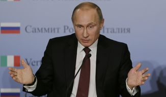 ** FILE ** Russian President Vladimir Putin gestures as he meets the media during a bilateral meeting between Italy and Russia, in Trieste, Italy, Tuesday, Nov. 26, 2013. (AP Photo/Luca Bruno)