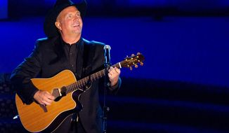 This June 16, 2011, file photo shows inductee Garth Brooks performing onstage at the 42nd Annual Songwriters Hall of Fame Awards in New York. (AP Photo/Charles Sykes, File) ** FILE **