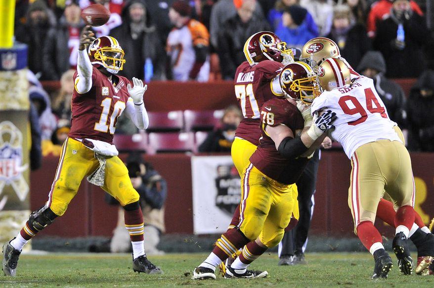 Washington Redskins guard Kory Lichtensteiger (78) and  tackle Trent Williams (71) give quarterback Robert Griffin III (10) time to throw against the San Francisco 49ers at FedExField, Landover, Md., Novermber 25, 2013. (Preston Keres/Special for The Washington Times)