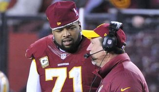 Washington Redskins tackle Trent Williams (71) talks to a coach on the sideline at FedExField, Landover, Md., Novermber 25, 2013. (Preston Keres/Special for The Washington Times)