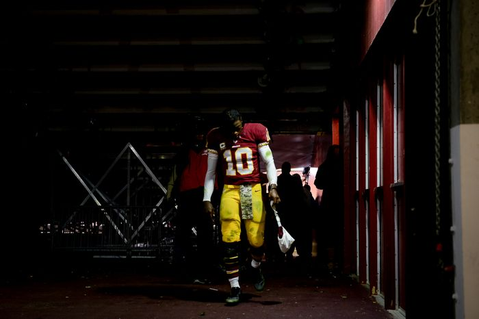 Washington Redskins quarterback Robert Griffin III (10),  heads to the locker room as the Washington Redskins lose to the San Francisco 49ers 27-6 in Monday Night Football at FedExField, Landover, Md., Tuesday, November 26, 2013. (Andrew Harnik/The Washington Times)
