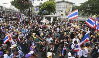 Anti-government protesters gather outside the Interior Ministry in Bangkok on Tuesday, Nov. 26, 2013. Demonstrators forced the closure of several government ministries and vowed to take control of state offices nationwide in a bid to oust Prime Minister Yingluck Shinawatra, escalating the biggest challenge she has faced since taking office. (AP Photo/Wason Wnnichakorn)