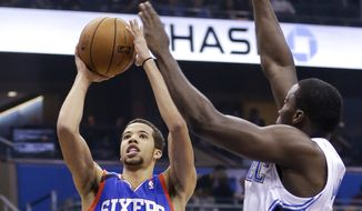 **FILE** Philadelphia 76ers' Michael Carter-Williams (1) makes a shot as he gets past Orlando Magic's Victor Oladipo, right, during the first half of an NBA basketball game in Orlando, Fla., Wednesday, Nov. 27, 2013.(AP Photo/John Raoux)