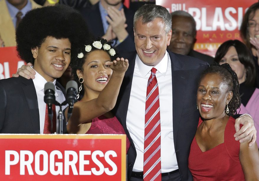 Democratic mayoral candidate Bill de Blasio celebrates on stage with his son dante, left, daughter Chiara and wife Chirlane McCray after he was elected the first Democratic mayor of New York City in 20 years in the Brooklyn borough of New York, Tuesday, Nov. 5, 2013.  De Blasio, who beat out Republican Joe Lhota by a large margin, follows the three-term reign of Republican-turned-independent billionaire Michael Bloomberg, and Republican Rudy Giuliani, who led the city in the wake of the 2001 terrorist attacks. (AP Photo/Kathy Willens)