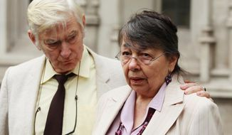 Peter Bull, 74, and his wife, Hazelmary, 69, the Christian owners of a hotel in southern England, leave the Supreme Court in London on Wednesday, Nov. 27, 2013, after losing an appeal over whether their refusal to let a gay couple stay amounted to discrimination. (AP Photo/Press Association, Sean Dempsey)