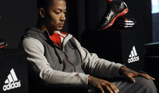 "FILE - In this Sept. 13, 2012 file photo, Chicago Bulls player Derrick Rose looks on during a press conference while unveiling his new shoe the Adidas D Rose 3 in Chicago. With Rose out for the season, industry experts say Adidas may need to rethink its NBA marketing campaign centered on the Chicago Bulls star. An Adidas spokeswoman says the sports apparel giant's plans remain unchanged ""at this time"" and will be updated as needed. (AP Photo/Paul Beaty, File)"