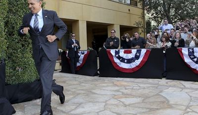 President Barack Obama runs to the stage after being introduced at DreamWorks Animation studio Tuesday, Nov. 26, 2013, in Glendale, Calif. (AP Photo/Los Angeles Times, Brian van der Brug, Pool)