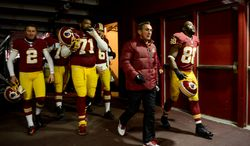 Washington Redskins head coach Mike Shanahan heads to the locker room with his team during halftime as the Washington Redskins play the San Francisco 49ers in Monday Night Football at FedExField, Landover, Md., Monday, November 25, 2013. (Andrew Harnik/The Washington Times)