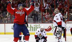 Washington Capitals right wing Eric Fehr (16) celebrates his goal past Ottawa Senators goalie Craig Anderson (41) in the first period of an NHL hockey game, Wednesday, Nov. 27, 2013, in Washington. (AP Photo/Alex Brandon)