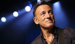 """FILE - This Nov. 7, 2013 file photo shows musician Bruce Springsteen stands on stage at the Stand Up for Heroes event at Madison Square Garden in New York. A handwritten working manuscript of Bruce Springsteen's 1975 hit """"Born to Run"""" will be offered at auction on Dec. 5 in New York. Sotheby's said Wednesday, Nov. 27, the presale estimate is $70,000 to $100,000. (John Minchillo/Invision/AP, File)"""