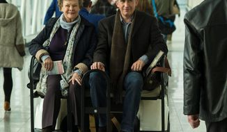 "Judi Dench, as the title character in ""Philomena,"" travels to the U.S. in search of the child taken from her years before. Steve Coogan plays the journalist accompanying her. (The Weinstein Company via Associated Press)"