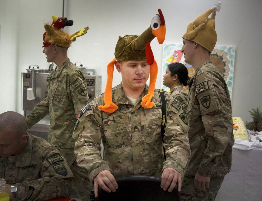 U.S. soldiers wear turkey-shaped hatsas they attend Thanksgiving dinner at their base in Kabul, Afghanistan, Thursday, Nov. 28, 2013. It's the 12th Thanksgiving in Afghanistan for U.S. troops. (AP Photo/Anja Niedringhaus)