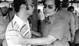 JONES AT JONESTOWN - Rev. Jimmy Jones, founder of People's temple, clasps an unidentified man at Jonestown, Nov. 18, 1978,  during Congressman' Leo J. Ryan's visit. Shortly after, Ryan, newsman Don Harris, Cameraman Bob Brown and San Francisco Examiner photographer Greg Robinson, who took this photo, were killed in ambush at Port Kaituma, Guyana. (AP-Photo/str/Greg Robinson)