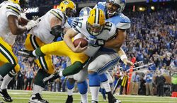 Detroit Lions defensive tackle Ndamukong Suh (90) sacks Green Bay Packers quarterback Matt Flynn for a safety during the third quarter of an NFL football game at Ford Field in Detroit, Thursday, Nov. 28, 2013. (AP Photo/Paul Sancya)