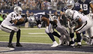 Dallas Cowboys running back DeMarco Murray (29) scores a touchdown against the Oakland Raiders during the first half of an NFL football game, Thursday, Nov. 28, 2013, in Arlington, Texas.  (AP Photo/Tim Sharp)