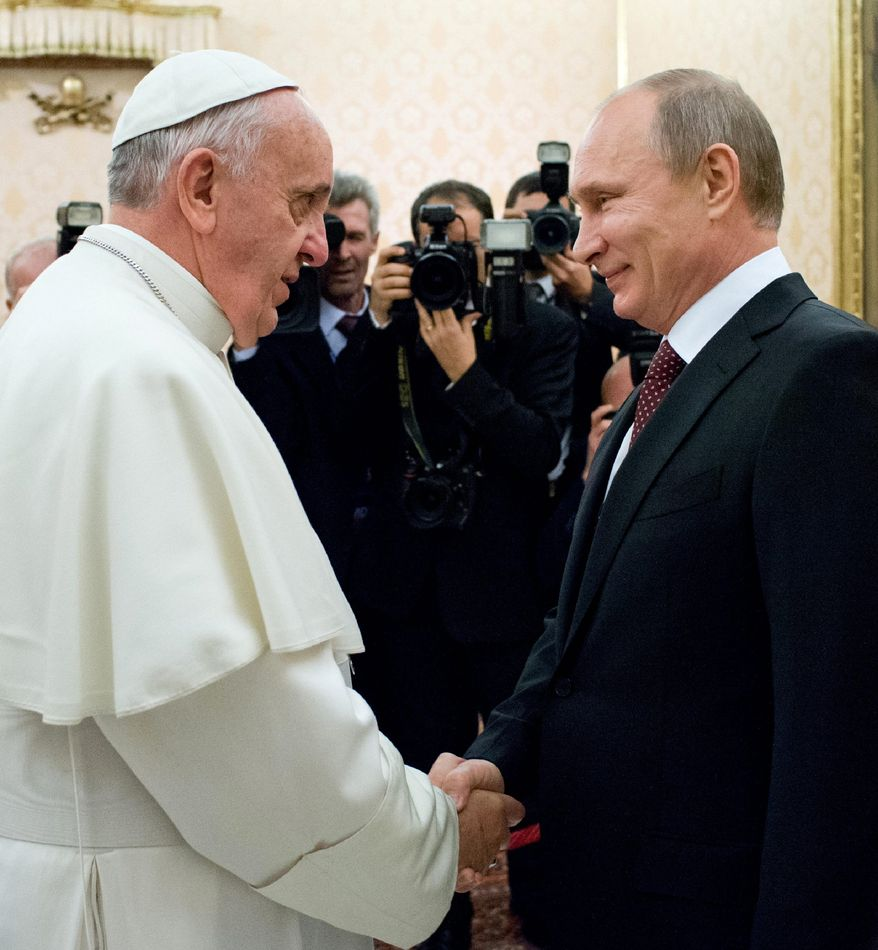 In this photo provided by the Vatican newspaper L'Osservatore Romano, Pope Francis welcomes Russian President Vladimir Putin, right, on the occasion of their private audience at the Vatican, Monday, Nov. 25, 2013. Putin and Francis met privately for 35 minutes Monday evening in the pope's private library. (AP Photo/L'Osservatore Romano, ho)