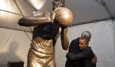 President Barack Obama is greeted by Bill Russell during a stop to view the statue of Russell at City Hall Plaza in Boston, Mass., Oct. 30, 2013. (Official White House Photo by Pete Souza)