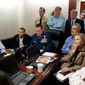 President Barack Obama and Vice President Joe Biden, along with with members of the national security team, receive an update on the mission against Osama bin Laden in the Situation Room of the White House, May 1, 2011. Please note: a classified document seen in this photograph has been obscured. (Official White House Photo by Pete Souza)