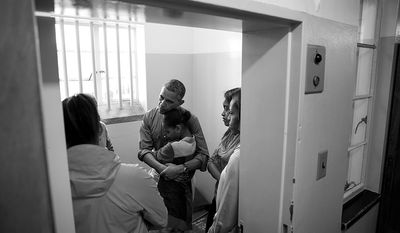 President Barack Obama and First Lady Michelle Obama, along with daughters Sasha and Malia, stand in former South African President Nelson Mandela's cell as they listen to former prisoner Ahmed Kathrada during their tour of Robben Island Prison on Robben Island in Cape Town, South Africa, June 30, 2013. Leslie Robinson and Marian Robinson join them. (Official White House Photo by Pete Souza)