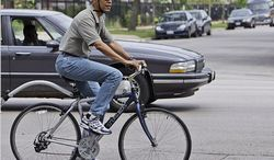 President Obama rides a bicycle in June, 2008. (credit: Associated Press)