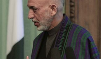 Afghan President Hamid Karzai speaks during a joint press conference with Pakistani Prime Minister Nawaz Sharif in Kabul, Afghanistan, Saturday, Nov. 30, 2013. Sharif said Saturday that the recent release of a senior Taliban leader shows he is committed to helping bring peace to Afghanistan. (AP Photo/Rahmat Gul)
