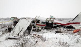 The wreckage of a plane that crashed on Friday, Nov. 29, 2013, near St. Marys, Alaska, is pictured the next day. Authorities said the pilot and three passengers died when the single-engine turboprop Cessna 208 went down, but few other details, including the possible cause of the crash, are known. (AP Photo/Alaska State Troopers)