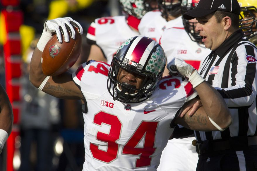 Ohio State running back Carlos Hyde (34) reacts after a run during the first quarter of an NCAA college football game against Michigan in Ann Arbor, Mich., Saturday, Nov. 30, 2013. (AP Photo/Tony Ding)