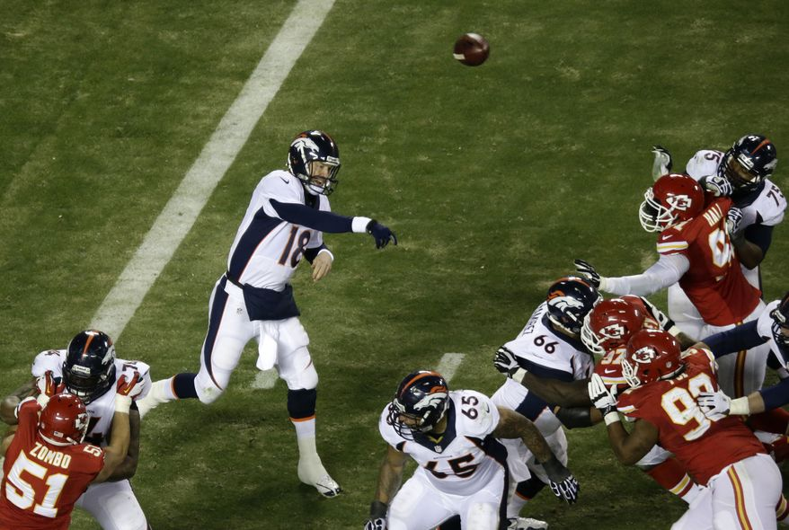 Denver Broncos quarterback Peyton Manning (18) thrown a pass against Kansas City Chiefs defense during the second half of an NFL football game, Sunday, Dec. 1, 2013, in Kansas City, Mo. (AP Photo/Charlie Riedel)