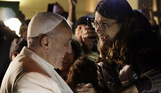 Pope Francis greets the faithful at the end of his visit at the Parish Church of St. Cirillo Alessandrino, in Rome, Sunday, Dec. 1, 2013. (AP Photo/Gregorio Borgia)