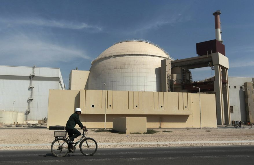 FILE - In this Oct. 26, 2010 file photo, a worker rides a bicycle in front of the reactor building of the Bushehr nuclear power plant, just outside the southern city of Bushehr, Iran. A report by Iran's official news agency quotes the country's nuclear chief, Ali Akbar Salehi, saying the Islamic Republic needs more nuclear power plants, just after it struck a deal regarding its contested nuclear program with world powers. Salehi said Iran is in serious talks with several countries including Russia to build four more nuclear power plants.(AP Photo/Mehr News Agency, Majid Asgaripour, File)