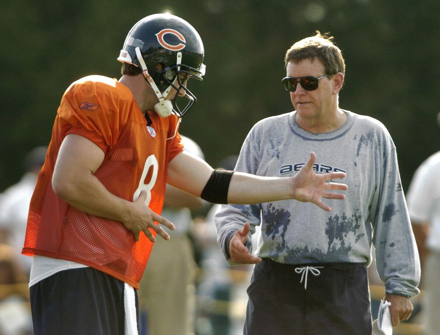 **FILE** Chicago Bears quarterback Rex Grossman, left, and offensive coordinator Terry Shea, right, discuss a play during training camp Sunday, Aug. 1, 2004, in Bourbonnais, Ill. (AP Photo/Jeff Roberson)
