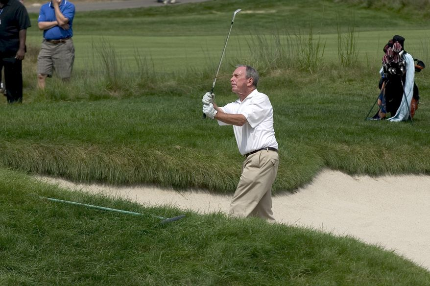 **FILE** New York City Mayor Michael Bloomberg hits out of a bunker on the 17th hole during the Deutsche Bank Championship Pro-Am golf tournament in Norton, Mass., on Aug. 28, 2008. (Associated Press)