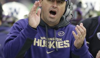 Washington head coach Steve Sarkisian yells from the sidelines against Washington State in the second half of an NCAA college football game Friday, Nov. 29, 2013, in Seattle. (AP Photo/Elaine Thompson)